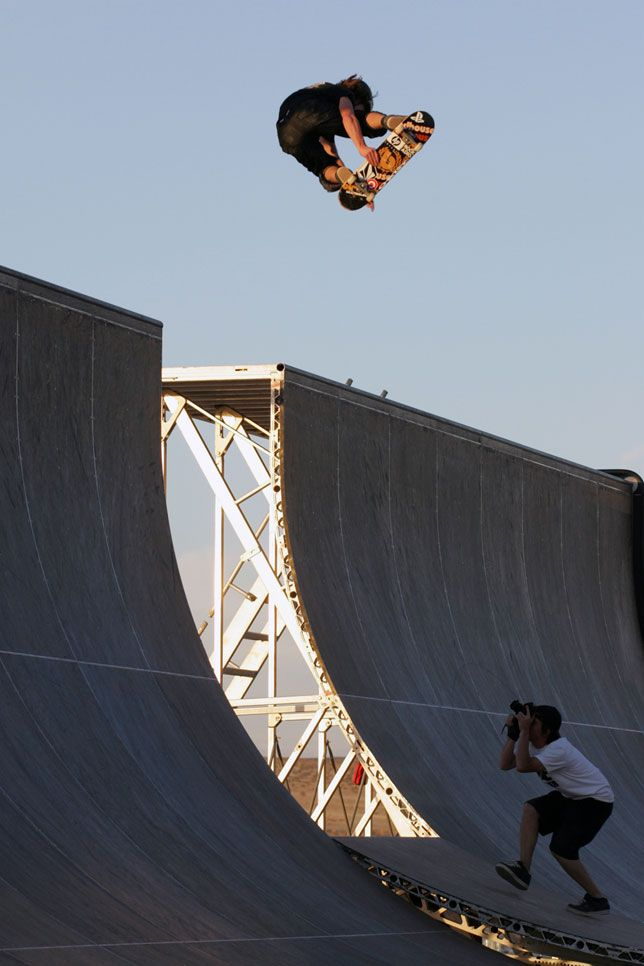 Shaun White spins over the channel on Tony Hawk's Boom Boom HuckJam ramp in the Mojave Desert, California 2006.