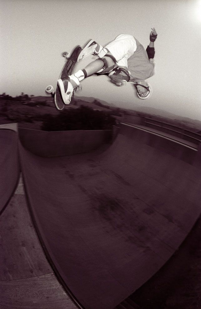Tony Hawk tips an Indy Nosebone above his backyard ramp in Fallbrook, California 1988.