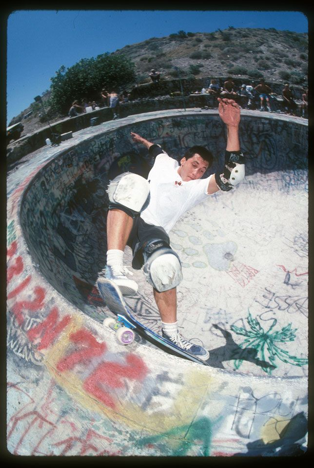 Alan Losi grinds up the deep end of the infamous Nude Bowl near Palm Springs, California, 1989.