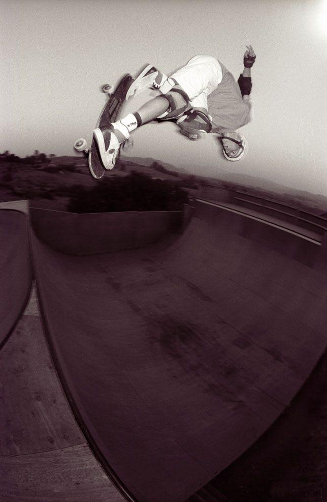Tony Hawk tips an Indy Nosebone above his backyard ramp in Fallbrook, California 1988.